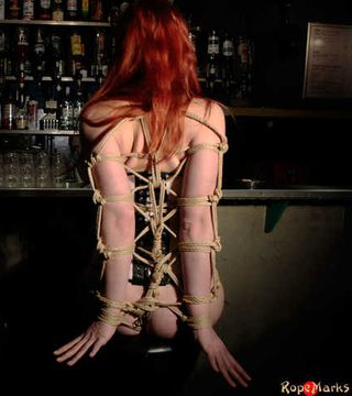 A sensual red head drooling at the bar