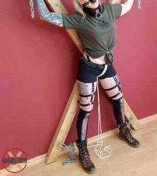 Ballgagged and chained on the cross