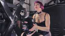 Mistress Tokyo - slave on the cross in latex with CBT