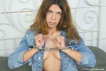 Sexy Jeansgirl Handcuffed