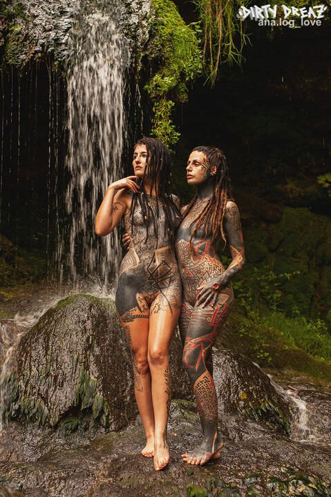 Tattooed cuties next to a waterfall - pictureset