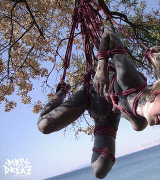 Shibari session at stunning ocean landscape
